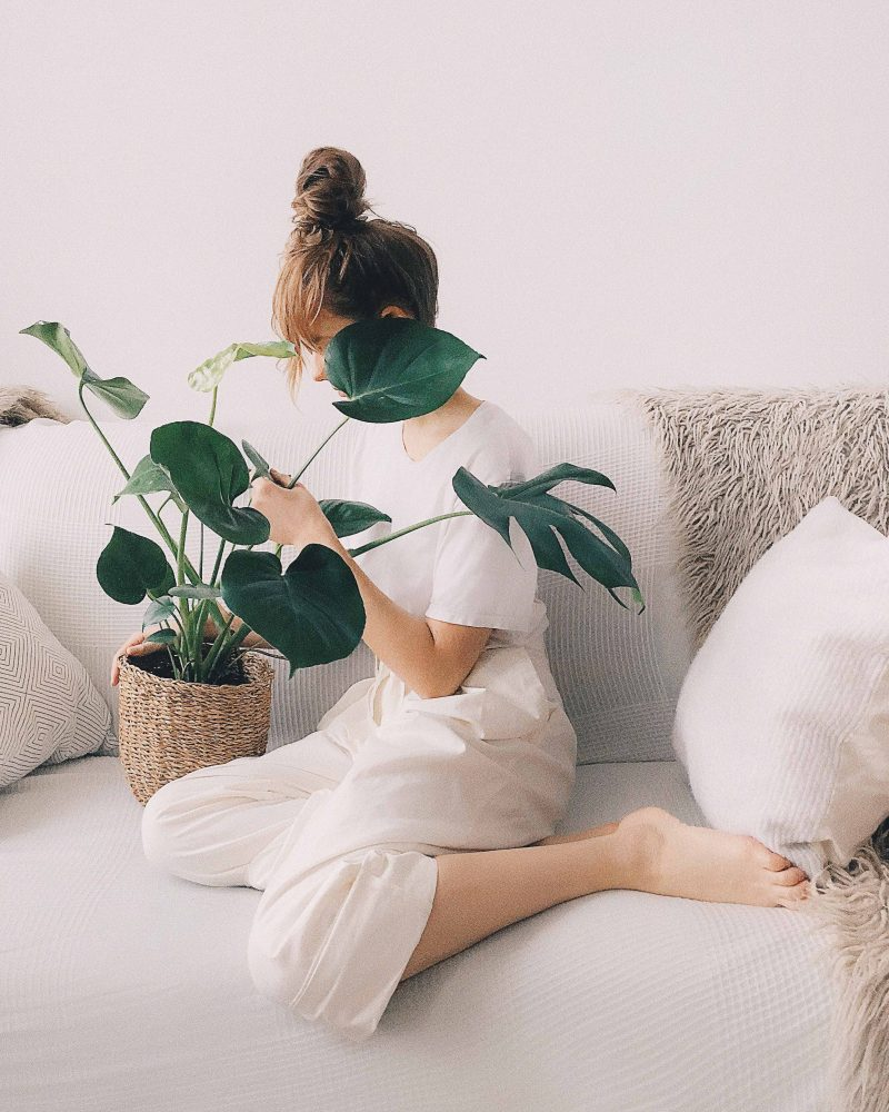 Image of woman checking plant