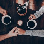 hand of people sharing coffee